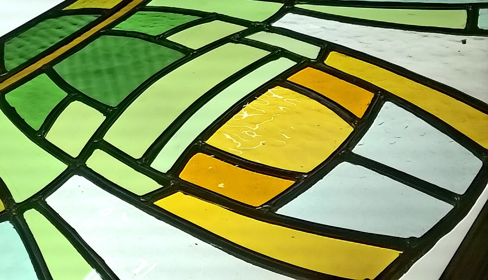 Detail glasraam voordeur bovenlicht